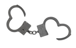Black old metallic handcuffs isolated Royalty Free Stock Photography
