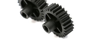 Black old plastic dirty cogwheel Stock Photography