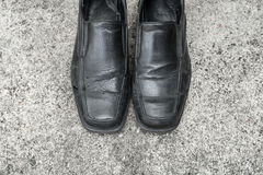 Black old shoes. It dirty and worn-out Stock Photos
