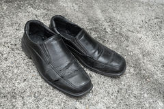 Black old shoes. It dirty and worn-out Stock Images