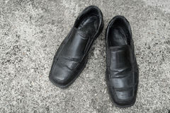 Black old shoes. It dirty and worn-out royalty free stock images