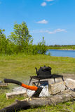 Black old smoked teapot on the campfire. On picnic in wood in the summer Royalty Free Stock Photo