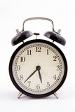 Black old style alarm clock Royalty Free Stock Image