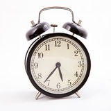 Black old style alarm clock with the clipping path Royalty Free Stock Image