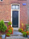 Black old style doors in Amsterdam Royalty Free Stock Image