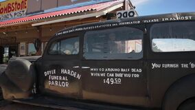 A black, old style hearse on display in Tombstone, Arizona
