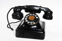 Vintage telephone. Vintage style telephone with a circular dial on a light background Royalty Free Stock Images