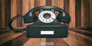 Black old telephone on wooden background. 3d illustration. Black old telephone isolated on wooden background. 3d illustration Royalty Free Stock Images