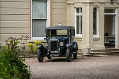 Black old vintage car on a driveway. Of a private property in England, Uk stock photo