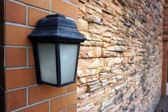 Black old vintage lamp on brick wall Royalty Free Stock Photos