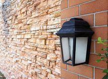 Black old vintage lamp on brick wall Stock Photos