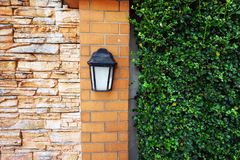 Black old vintage lamp on brick wall Royalty Free Stock Photography