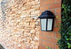 Black old vintage lamp on brick wall Royalty Free Stock Photo