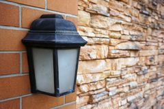 Black old vintage lamp on brick wall Stock Images