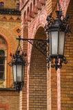 Black old vintage lamps on brick wall in old town castle. Beautiful arch Royalty Free Stock Photos