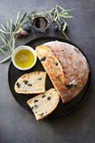 Black Olive Bread with a glass of red wine and olive oil Royalty Free Stock Image