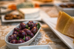Black olive. Portion with cheese on the side Stock Images