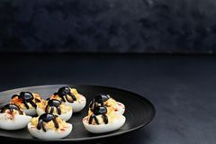Black Olive Spiders and Deviled Eggs Stock Photos