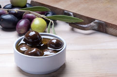 Black olive on a wodden board Stock Photo
