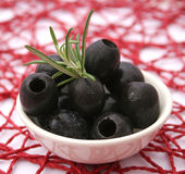 Black olives. Some fresh olives in a bowl royalty free stock photography
