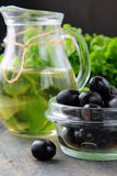 Black olives and a bottle of olive oil Royalty Free Stock Photo