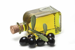 Black olives and a bottle of olive oil. Stock Photo