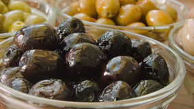 Black olives in a bowl stock footage