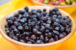 Black Olives in a Bowl. A bowl of fresh unseeded black olives royalty free stock photos