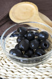 Black olives in bowl Stock Photography