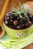 Black olives in the bowl Stock Photos