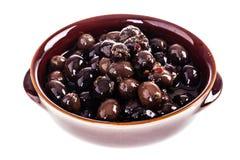 Black olives bowl isolated Royalty Free Stock Photography