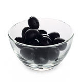 Black olives. In a bowl isolated on white background Stock Photos
