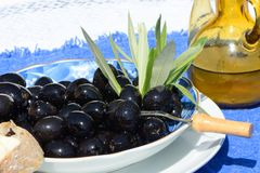 Black olives,bread and oil Royalty Free Stock Images
