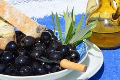 Black olives, bread and oil Royalty Free Stock Image