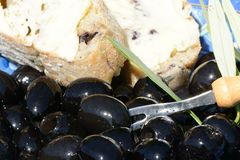 Black olives and bread. Royalty Free Stock Photo