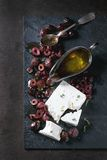 Black olives and feta cheese Stock Photos