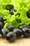 Black olives and greens Royalty Free Stock Photography