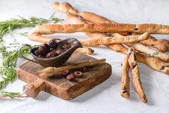 Black olives and grissini bread Stock Images