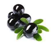 Black olives with leaves, isolated. On white royalty free stock photos
