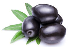 Black olives with leaves. Royalty Free Stock Images