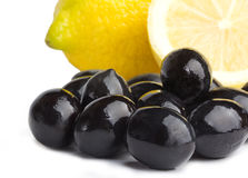 Black olives and lemon Stock Photos