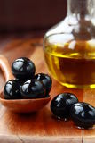 Black olives and Olive Oil Royalty Free Stock Photography