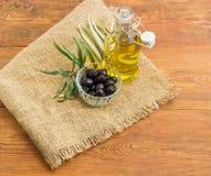 Black olives, olive oil and olive branch Stock Image