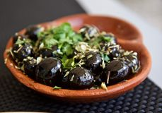 Black Olives. The Olive`s fruit, also called the olive, is of major agricultural importance in the Mediterranean region as the source of olive oil; it is one of Stock Photos