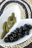 Black olives with pickles serve on plate Stock Image
