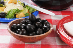 Black olives on a picnic table Royalty Free Stock Photo