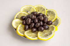 Black olives and segments of a lemon Stock Images