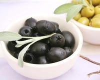 Black olives. Some black olives in a bowl Royalty Free Stock Images
