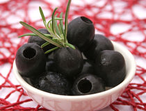 Black olives. Some fresh black olives in a bowl royalty free stock photo