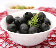 Black olives. Some fresh, black olives in a bowl stock photos